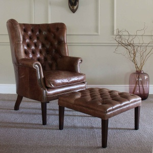 Tetrad Harris Mackenzie Chair in leather shown with Mackenzie Footstool